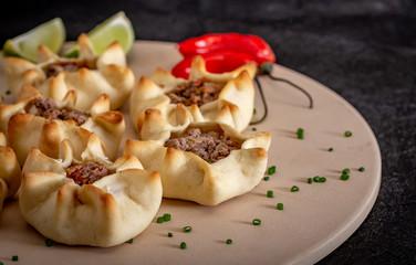Arabian opened meat esfiha on rustic background.