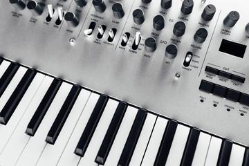 metallic analog synthesizer, close-up view