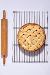 Apple pie with lattice work and rolling pin, copyright Diana Koenigsberg 2018