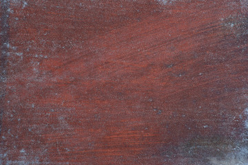 The texture of the metal with stains and stripes. Textural background of red-brown metal with dirty strokes. Design on metal with stains and strokes.