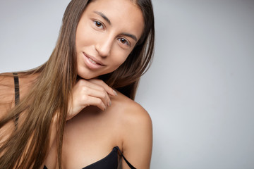 Young female model portrait with black lingerie top and long hair