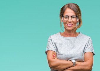 Middle age senior hispanic woman wearing glasses over isolated background happy face smiling with crossed arms looking at the camera. Positive person. Wall mural