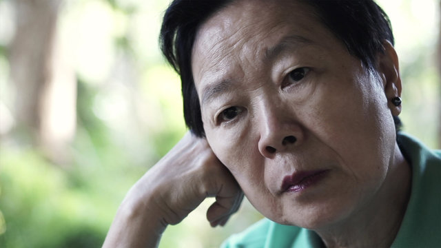 Asian senior elderly woman worry expression thinking about life