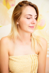 Portrait of beautiful blonde girl smiling waiting for spa treatments or cosmetologist.