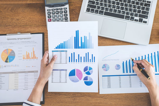 Female accountant calculations, audit and analyzing financial graph data with calculator and laptop Business, Financing, Accounting, Doing finance, Economy, Savings Banking Concept