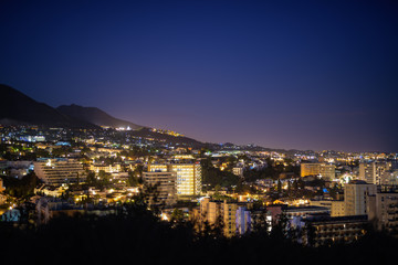 Beautiful Night View On Top Of Hill Overlooking The City Of Malaga, Spain At Night