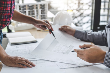 Architecture Engineer Teamwork Meeting, Drawing and working for architectural project and engineering tools on workplace, concept of worksite on technical drawing structure and construction