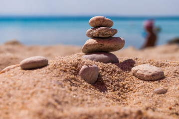 Close-up of a pyramid of stones laid on a sea beach