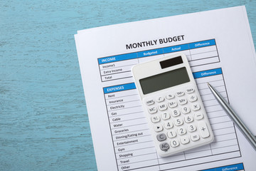 Monthly budget concept on blue wood desk background
