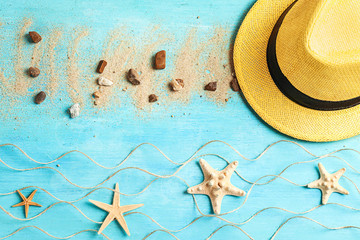 Flat lay composition with beach hat and starfishes on color background