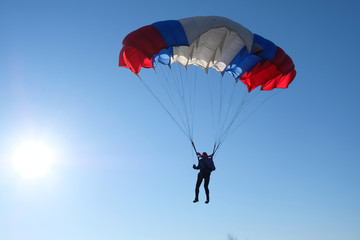 An accurate skydiver is landing.