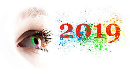 Colorful rainbow female eye and colored 2019 splashing