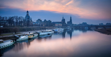 Dresden. Panoramic image of Dresden, Germany during sunset with Elbe River in the foreground.