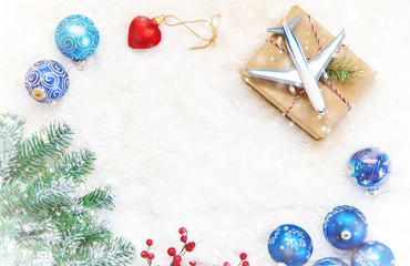 Christmas background on the theme of travel. The plane symbolizes the gift of the journey. Selective focus.