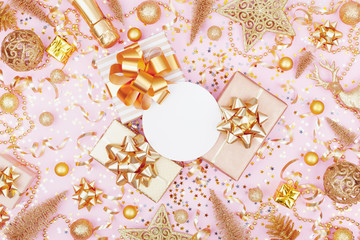 Christmas background with paper blank, gift or present box and golden holiday decoration top view. Flat lay.