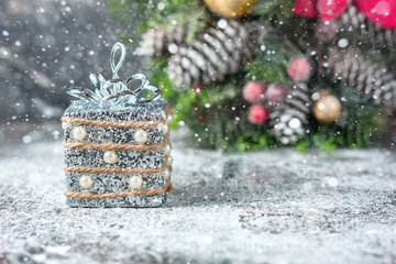 Silver and white xmas ornaments on rustic wood background. Merry christmas card. Space for text.