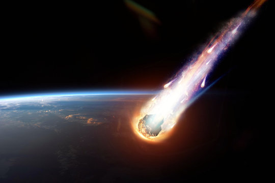 A comet, an asteroid, a meteorite glows, enters the earth's atmosphere. Attack of the meteorite. Meteor Rain. Kameta tail. End of the world. Elements of this image furnished by NASA. Mixed media.