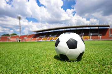 soccer ball on soccer field green grass , football field  athletics stadium and blue sky background
