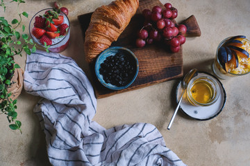 Breakfast in the provincial style with fresh berries and pastries, granola berries.