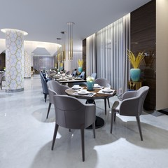 Luxurious modern restaurant in the evening lighting with blue and beige chairs and laid out tables. White columns in a mosaic tile. Gold plated pendant lights.