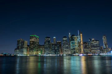 Fotobehang - View of the city of New York and the bay. New York.   Long light exposure.