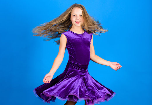 Girl child wear velvet violet dress. Kid fashionable dress looks adorable. Ballroom dancewear fashion concept. Kid dancer satisfied with concert outfit. Clothes for ballroom dance. Ballroom fashion
