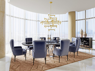 A meeting room in art deco style with a large table and luxurious soft chairs.