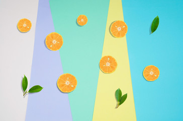 Top view Orange  fruit slice and green leaf   isolated on pastel color background .