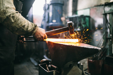 blacksmith working with metal