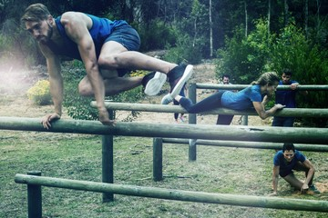 People jumping over the hurdles during obstacle course