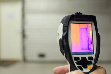 Thermal imaging camera, checking heat leaks at the warehouse. Copy space.