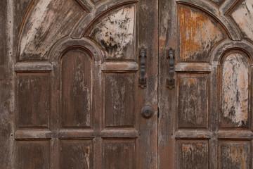 Metal old rusty handle on wooden door
