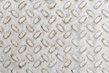Steel sheet with notches - gray vintage metal abstract light coloured background, texture close-up