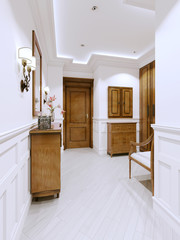 Hall entrance hall in a modern apartment in a classic style, with a chest of drawers and wall panels in white.