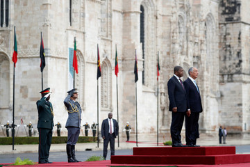 Angolan President Joao Lourenco is welcomed by Portugal's President Marcelo Rebelo de Sousa at Jeronimos Monastery in Lisbon