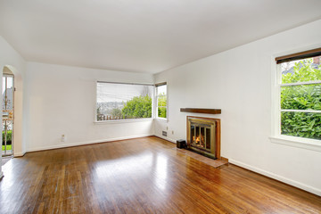 Empty craftsman style living room interior with fireplace.