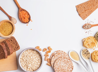 Different types of high carbohydrate food on the white background.