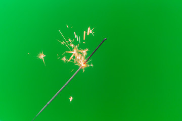 Sparkler isolated on green screen background
