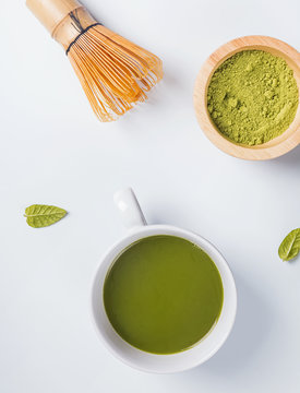 Traditional japanese green tea matcha in a cup, whisk and powder