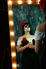 Image of zombie woman with white face and red flower on her head