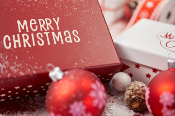 Red and white gift boxes in snow. Isolated on xmas background