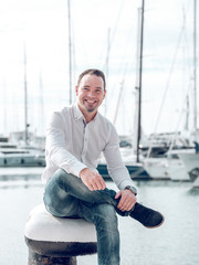 Cheerful businessman in harbor