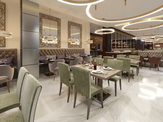 Restaurant in a modern style with marble floor. There are sofas chairs with tables, decorative stainless columns. On ceiling big chandelier with gold circles. Large closet with bottles and light.