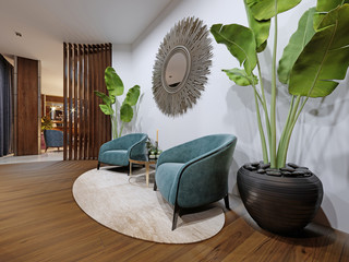 The hotel?s rest area features two designer armchairs in blue with a potted plant and a zeokal on a white wall.