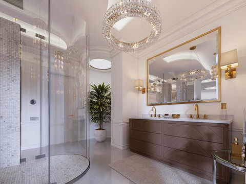 Modern bathroom with vanity and a mirror in a gold frame with sconces on the wall, a low table with decor, shower and a fashionable bath.