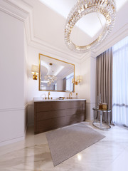 Modern wooden vanity with a mirror in a gold frame and sconces on the wall, a low table with decor and a rug with a chandelier.