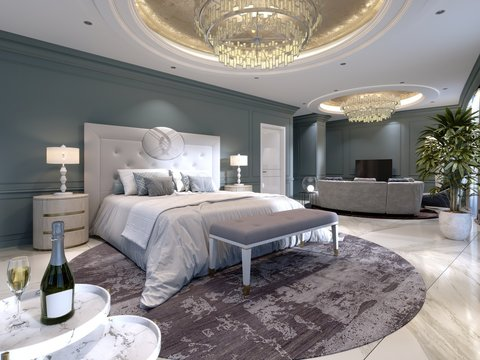 Luxury presidential suite with a bedroom and a large bed and a living room with a sofa and a TV stand.