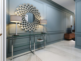 The corridor in the apartment with a modern metal console with glass shelves and luminous lamps and a round mirror on the wall. Hall corridor interior design with blue walls and white doors.