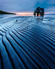 Wonderful dark sand after the tide. Location place Hvitserkur, island Iceland, Europe.