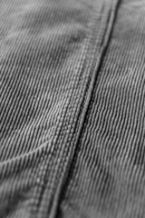 seam on grey ribbed corduroy. corduroy fabric texture